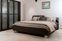 Кровать с подвижным изголовьем ELUMO II от Hulsta